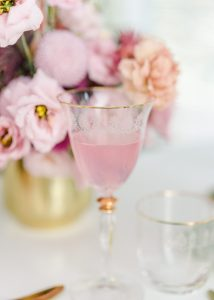 glass with pink bubbly