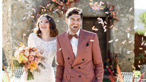 couple showered in confetti after ceremony